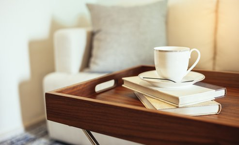 Pillow Sofa Home Interior Coffee cup Books on wooden table
